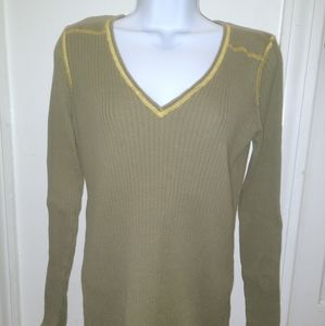 Athleta green top with yellow stitching